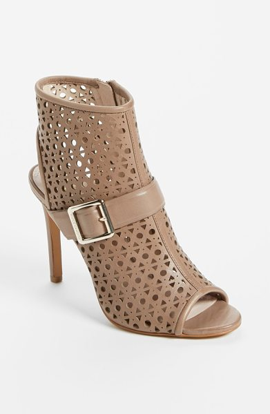 Vince Camuto 'kaleen' leather bootie in cafe au lait - Geometric perforations punctuate a contemporary peep-toe...