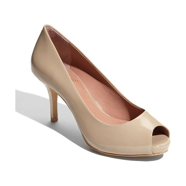 VINCE CAMUTO kira pump - A slender wrapped heel grounds a glossy leather pump...
