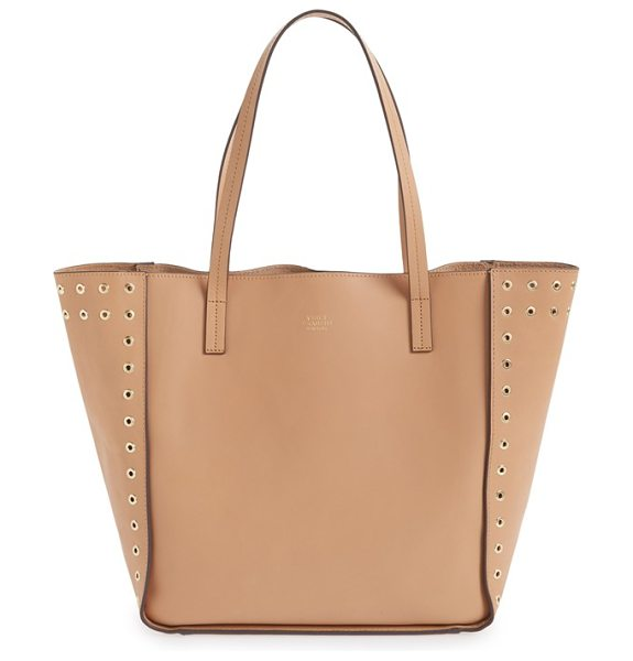 Vince Camuto Punky leather tote in natural vachetta - Eye-catching rivets outline the side panels of a sleek...