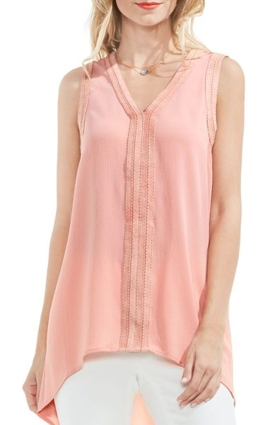 Vince Camuto ribbon trim high/low blouse in coral dusk - Textured ribbons frame the V-neck and arm openings of a...