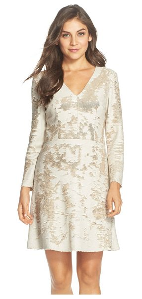Vince Camuto sequin fit & flare dress in gold - A medley of white and gold sequins pattern a long-sleeve...