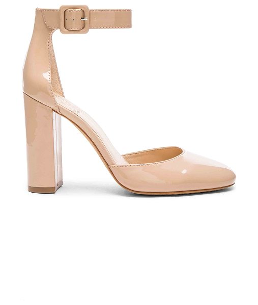 Vince Camuto Shaytel Heel in beige - Patent leather upper with man made sole. Ankle strap...