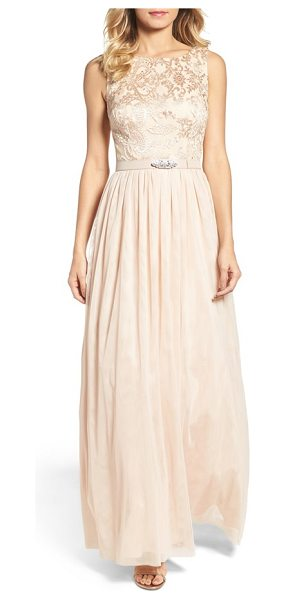 VINCE CAMUTO sleeveless gown in champagne - A crystal-encrusted belt and embroidered lace bodice...