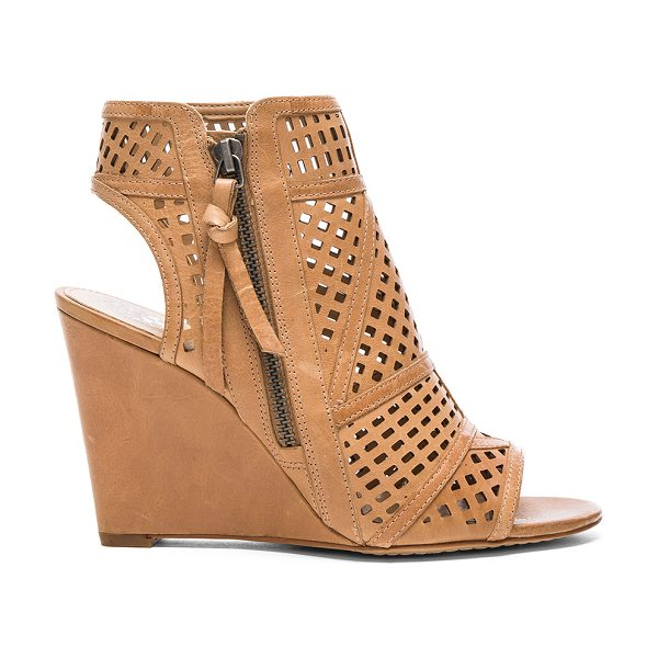 VINCE CAMUTO Xabrina Wedge - Leather upper with man made sole. Side zip closure....
