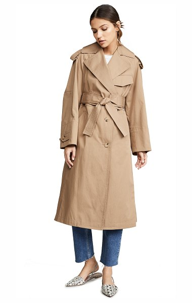 Vince cotton trench coat in dk khaki - Fabric: Twill Epaulets at shoulder Notched lapels Long...