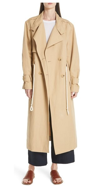 Vince double breasted long trench coat in beige - Repackaged with fashion-forward details, this Italian...
