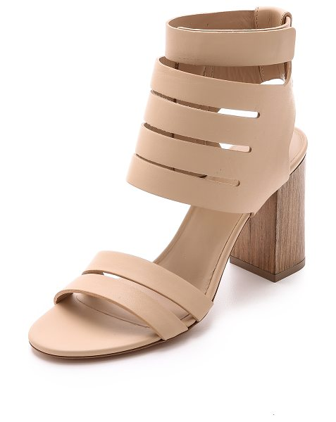 VINCE Freida sandals in nude - Slim cutouts accent the substantial strap on these...