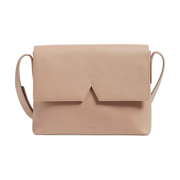 VINCE Medium signature leather crossbody bag in nude - Crafted from a single piece of Italian leather, this...