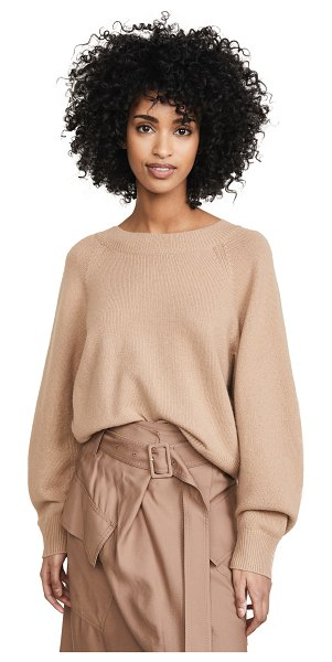 Vince raglan sleeve dolman pullover in camel - Fabric: Lightweight chunky knit Ribbed knit edges...