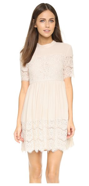 Wayf Lace trim babydoll dress in nude - Lace trim and soft gathers accentuate the sweet feel of...