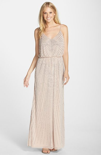 Xscape beaded blouson gown in blush - Twinkling beads radiate across the blouson bodice and...