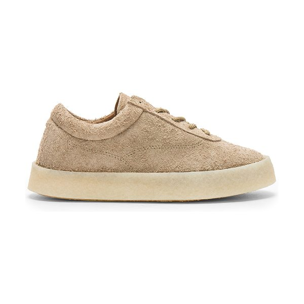 "YEEZY Season 6 Women's Crepe Sneaker in taupe - ""Raw suede upper with rubber sole. Lace-up front...."