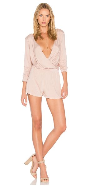 YFB CLOTHING Blair Romper in pink - 96% cupro 4% spandex. Hand wash cold. Surplice neckline...