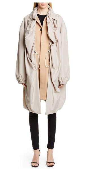 Y/PROJECT layered coat in brown - A water-resistant layer that's haphazardly ruched for...