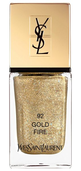 Yves Saint Laurent dazzling lights la laque couture nail polish in 92 gold fire - What it is: A limited-edition nail polish in sparkling...