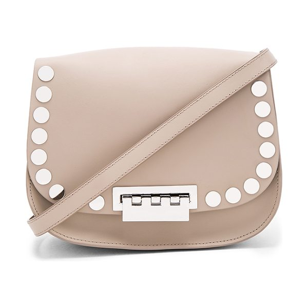 Zac Zac Posen Eartha Iconic Saddle Bag in taupe - Leather exterior and lining. Flap top with fold over...