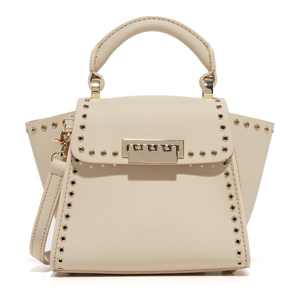 Zac Zac Posen Grommet eartha top handle mini bag in cream - Polished grommets trim this petite leather ZAC Zac Posen...