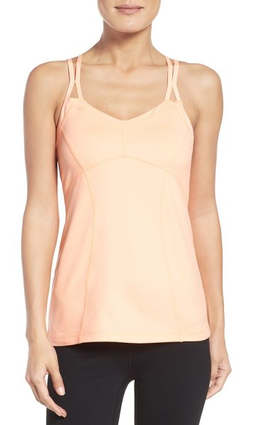 Zella jewel tank in coral sunlight - Sculpted seaming both highlights curves and allows for a...