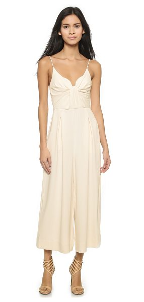 Zimmermann Reveal jumpsuit in pearl - Gentle folds cinch in the center of this shoulder baring...