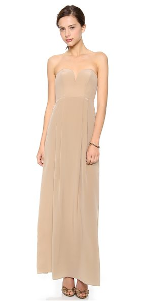 Zimmermann Strapless maxi dress in latte - Sweet meets sexy. This strapless silk gown has a notched...