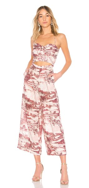 "Zimmermann Tie Front Jumpsuit in pink - ""Zimmermann brings your dream destination to you with..."