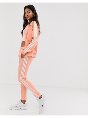 Adidas Originals adicolor three stripe cigarette pant in pink