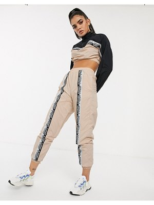 Adidas Originals ryv taping track pants in blush-cream