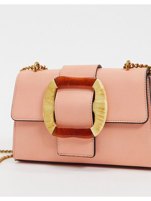 ASOS DESIGN cross body bag with statement buckle-pink