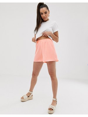 ASOS DESIGN elasticated waist shorts in bright peach-pink