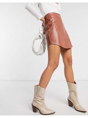 ASOS DESIGN leather look mini skirt with curved hem in tan-brown