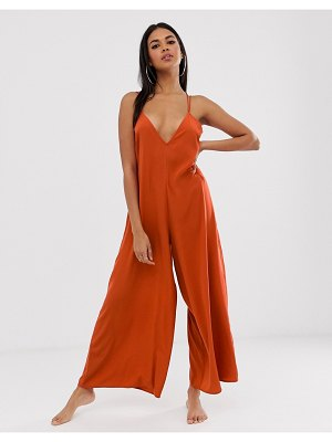 ASOS DESIGN minimal beach jumpsuit with strappy back in ginger