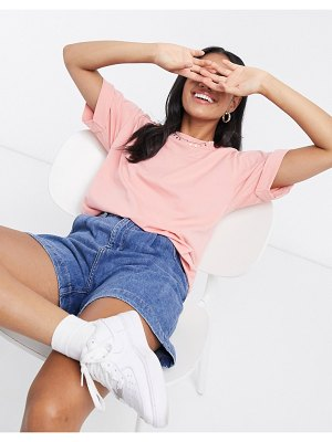 ASOS DESIGN relaxed t-shirt with roll sleeve in pink