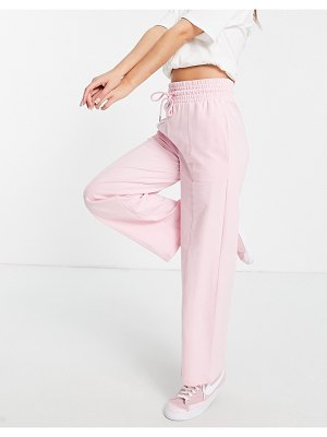 ASOS DESIGN straight leg sweatpants with deep waistband and pintuck in organic cotton in baby pink