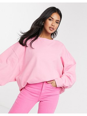 ASOS DESIGN super oversized cocoon sweatshirt with panel detail in pink
