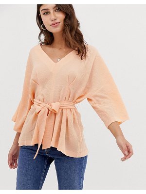 ASOS DESIGN textured 3/4 sleeve oversized top with v neck and tie waist