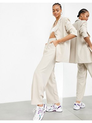 ASOS Edition pleated wide leg pants in stone-neutral