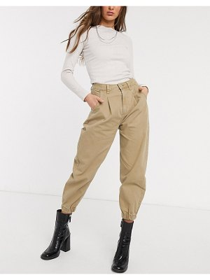 Bershka slouchy jean with cuff detail in camel-brown