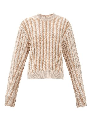 Chloe chunky cable-knit side-slit wool-blend sweater