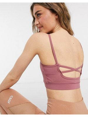 In The Style x courtney black activewear strappy crop top in pink