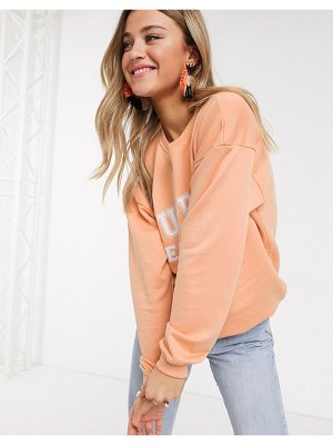 In The Style x meggan grubb motif oversized sweat top in coral-pink
