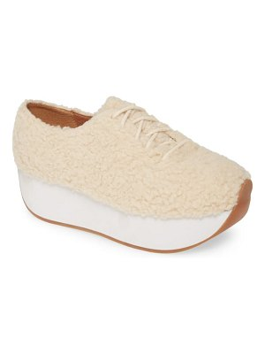 JAGGAR curved faux shearling platform sneaker