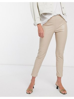 MANGO button detail faux leather slim pants in beige