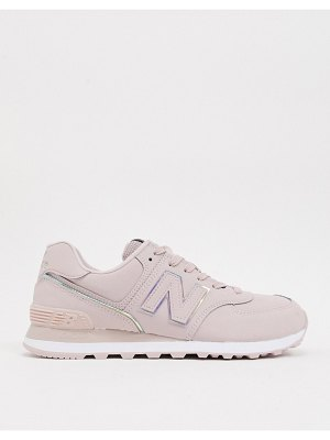 New Balance 574 sneakers in pink with iridescent piping
