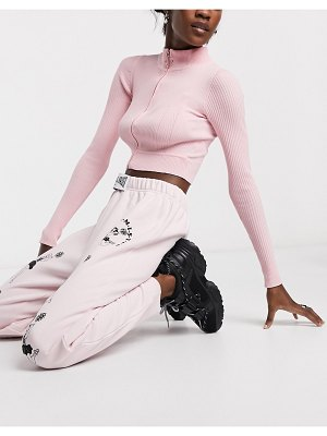 New Girl Order relaxed sweatpants with 'be optimistic' print co-ord-pink