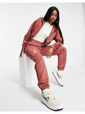 Nike icon clash sweatpants in clay red-stone