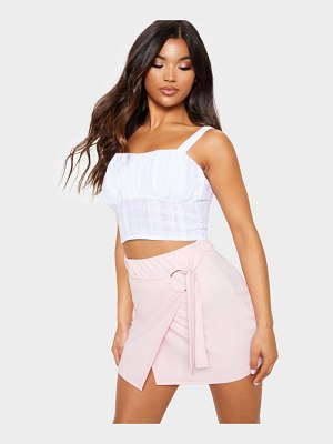 PrettyLittleThing baby pink o ring wrap front mini skirt