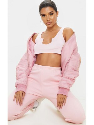 PrettyLittleThing basic baby pink jersey deep v raw edge crop top
