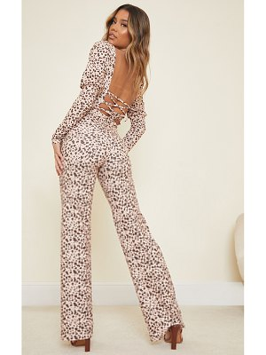 PrettyLittleThing dalmatian print lace up back puff sleeve jumpsuit