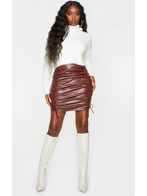 PrettyLittleThing faux leather ruched tie detail mini skirt