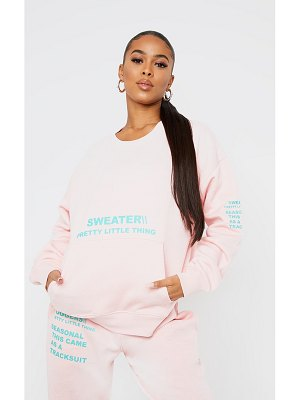 PrettyLittleThing light pink oversized slogan print pocket front sweater